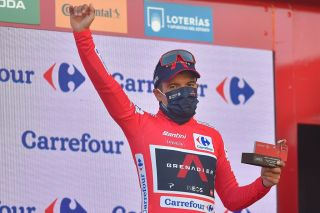 Team Ineos Ecuadorian rider Richard Carapaz celebrates on the podium as he keeps his overall race leader position after the 9th stage of the 2020 La Vuelta cycling tour of Spain a 1577km race from Castrillo del Val to Aguilar de Campoo on October 29 2020 Photo by ANDER GILLENEA AFP Photo by ANDER GILLENEAAFP via Getty Images