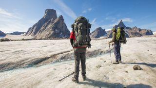 two hikers wearing backpacks