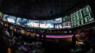 Guests attend a viewing party for the NCAA Men's College Basketball Tournament inside the 25,000-square-foot Race & Sports SuperBook at the Westgate Las Vegas Resort & Casino which features 4,488-square-feet of HD video screens on March 15, 2018 in Las Vegas, Nevada.
