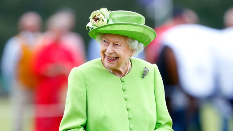 The Queen, Elizabeth II attends the Out-Sourcing Inc. Royal Windsor Cup polo match and a carriage driving display by the British Driving Society at Guards Polo Club, Smith's Lawn on July 11, 2021 in Egham, England.