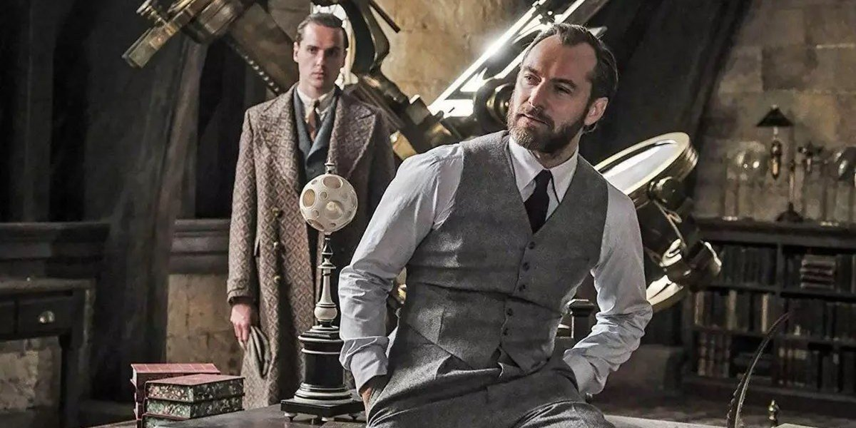 Albus Dumbledore perches on his desk in a scene from 'Fantastic Beasts: The Crimes of Grindelwald'