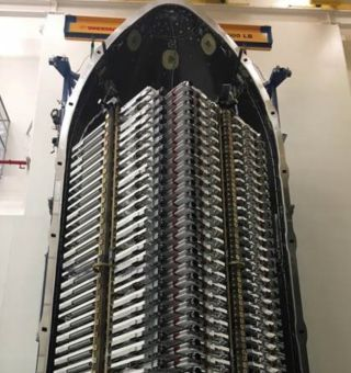 Sixty satellites for SpaceX's Starlink megaconstellation are stacked in their payload fairing ahead of a planned May 15, 2019, launch.