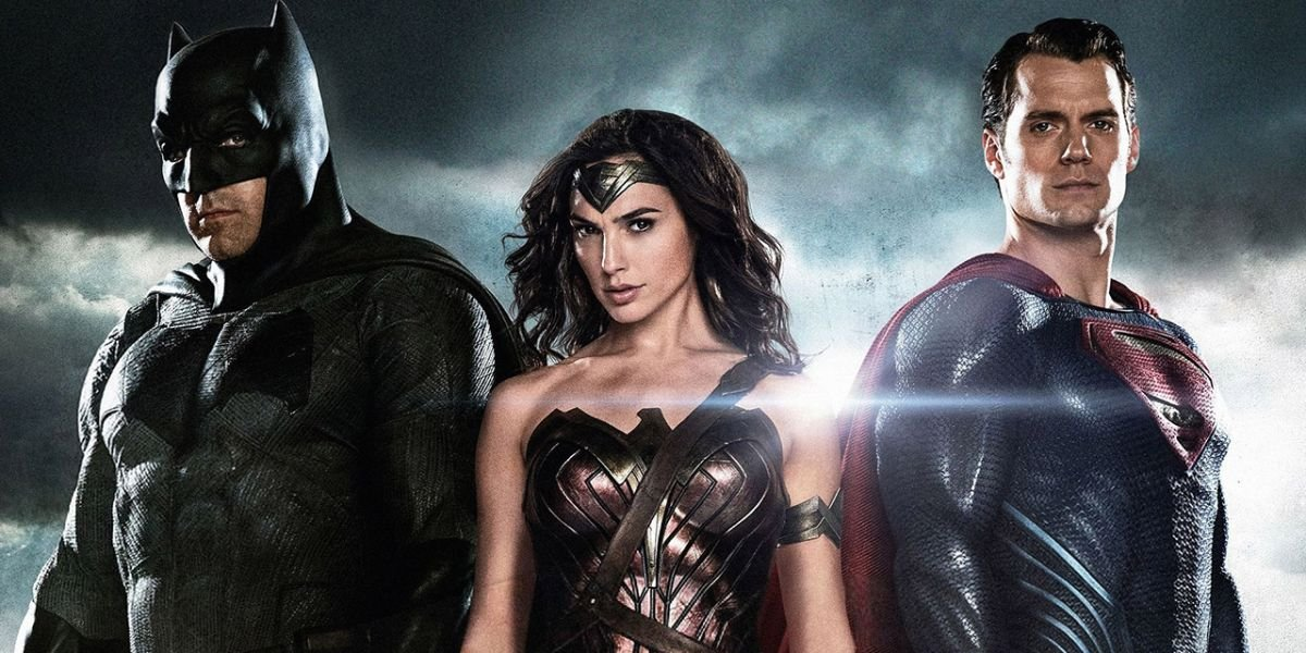 Batman v Superman: Dawn of Justice Batman, Wonder Woman, and Superman posing in front of some clouds