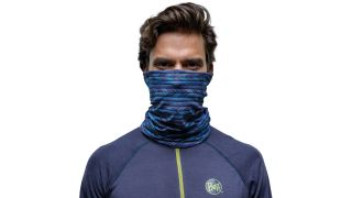 Backpacking essentials: man wearing a Buff neck scarf
