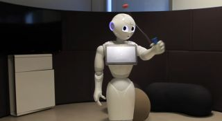 Watch Pepper the robot learn how to catch a ball in a cup