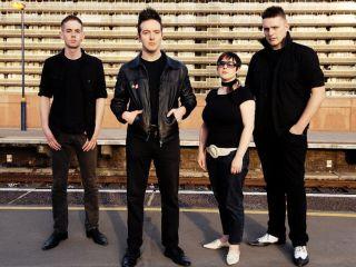 Frontman James Allan second left talks in depth to MusicRadar