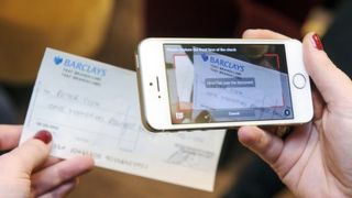 Say cheese! UK to trial depositing cheques via smartphone photos