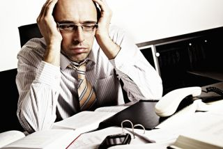 stressed and tired businessman at his desk.
