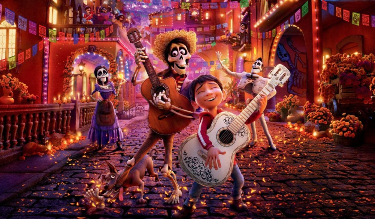 Coco Miguel and Hector playing guitar in the streets