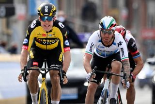 Belgian Wout Van Aert of Team JumboVisma L sprints to win over Italian Giacomo Nizzolo of Qhubeka Assos a at the finish of the GentWevelgem In Flanders Fields 2475 kilometers road cycling race from Ypers to Wevelgem on March 28 2021 Home rider Wout van Aert of JumboVisma won the GentWevelgem cycling classic in Belgium edging Italian pair Giacomo Nizzolo and Matteo Trentin The powerful 26yearold also won the MilanSan Remo and Strade Bianche classics in 2020 and has emerged as a major force in the sport Belgium OUT Photo by DIRK WAEM various sources AFP Belgium OUT Photo by DIRK WAEMBelgaAFP via Getty Images
