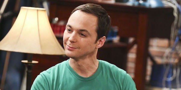 Sheldon smiling in the apartment