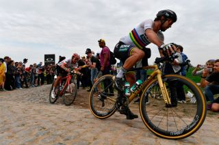 Slovakias Peter Sagan R competes to win ahead of Switzerlands Silvan Dillier during the 116th edition of the ParisRoubaix oneday classic cycling race between Compiegne and Roubaix on April 8 2018 near Compigne northern France AFP PHOTO JEFF PACHOUD Photo credit should read JEFF PACHOUDAFP via Getty Images