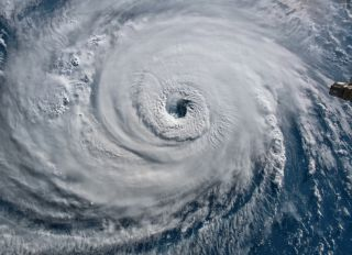 A satellite image of Hurricane Florence, which hit the East Coast in 2018, causing a lot of damage in the Carolinas.