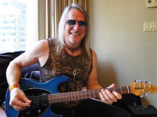 Happy You bet Steve Morse is happy He s holding a guitar isn t he