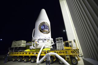 The Orbital ATK Cygnus spacecraft to launch NASA cargo on the OA-7 mission is seen here, inside its protective payload fairing, en route to be mated to its Atlas V rocket ahead of its launch from Cape Canaveral Air Force Station in Florida.