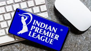 Indian Premier League logo on a smartphone on top of a computer keyboard