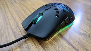 The Marsback Zephyr Pro gaming mouse from the front - the scroll wheel is lit up green