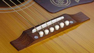 how to set acoustic guitar saddle height musicradar. Black Bedroom Furniture Sets. Home Design Ideas