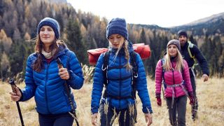 Hikers on a winter walk wearing hats