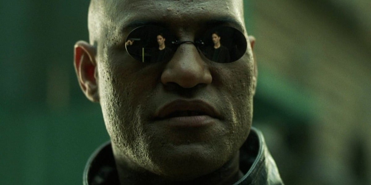 The Matrix's Neo's (Keanu Reeves) reflection is visible in Morpheus' (Laurence Fishburne) sunglasses.