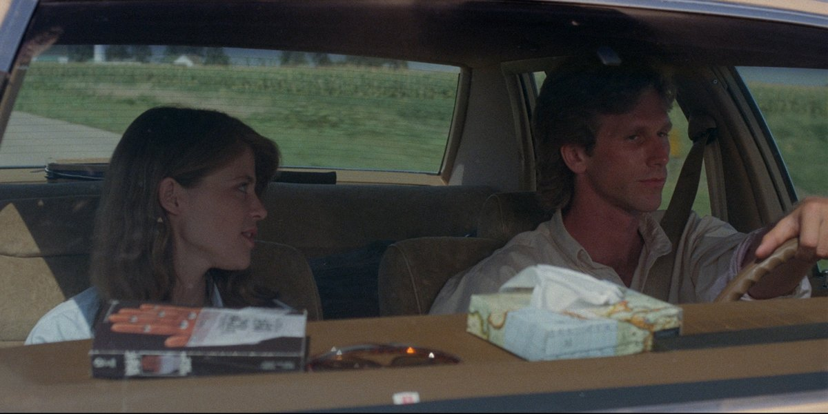 Children of the Corn driving in car, night shift on dash