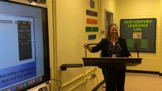 Teacher teaches with interactive flat panel