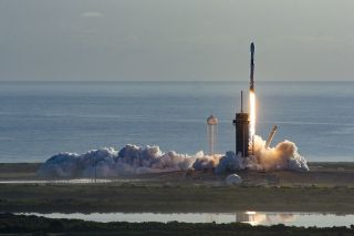 A SpaceX Falcon 9 rocket carrying 60 Starlink internet satellites lifts off from NASA's Kennedy Space Center in Florida on March 18, 2020.