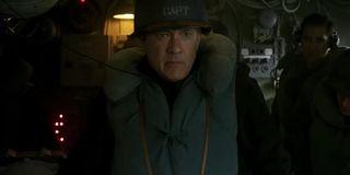 Greyhound Tom Hanks on the bridge, with a helmet and life jacket