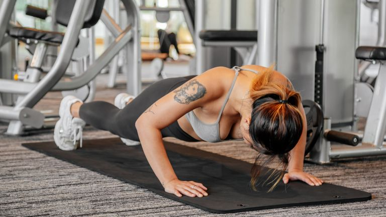 Women doing push up in gym setting