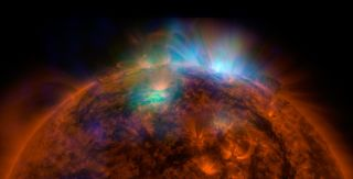 The first image of the sun captured by NASA's Nuclear Spectroscopic Telescope Array (NuSTAR), which is sensitive to high-energy X-ray light. X-rays seen by NuSTAR show up as green and blue in the photo, which is overlaid on an image taken by NASA's Solar