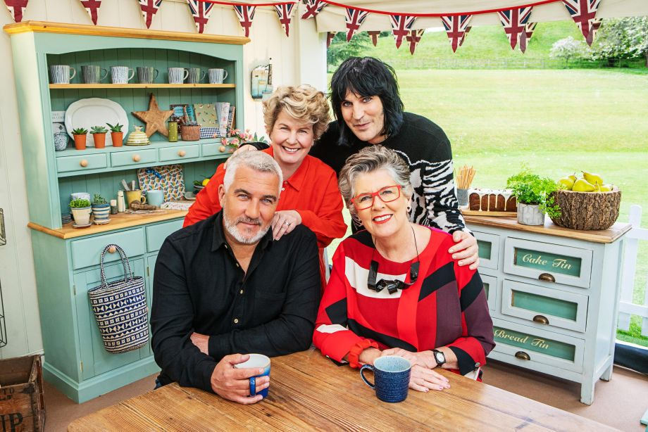 The Bake Off judges at a kitchen table
