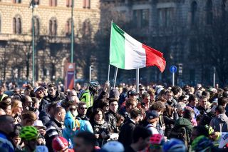 The Italian flag flies at the start of Milan-San Remo