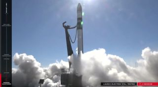 The second launch of a Rocket Lab Electron booster, seen here during an aborted launch try on Dec. 11, 2017, has been delayed until early 2018, the company said Dec. 16.
