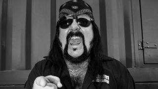 A press shot of Vinnie Paul pointing at the camera