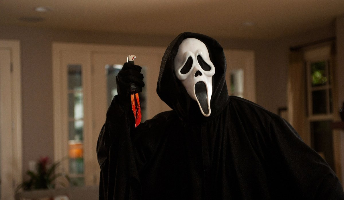 Scream Ghostface holding a bloody knife in its' hands