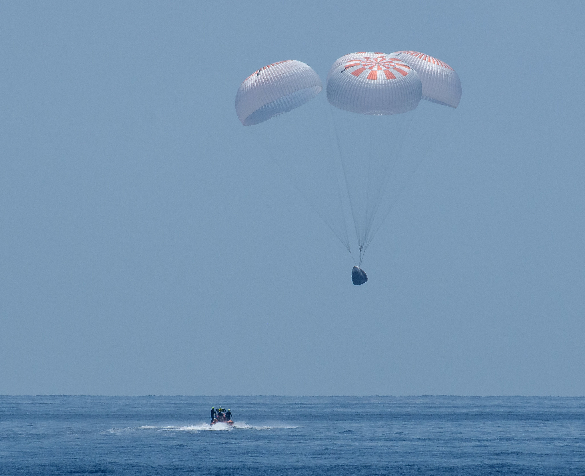 The SpaceX Crew Dragon Endeavour spacecraft is seen as it lands with NASA astronauts Robert Behnken and Douglas Hurley onboard in the Gulf of Mexico off the coast of Pensacola, Florida, Sunday, Aug. 2, 2020.