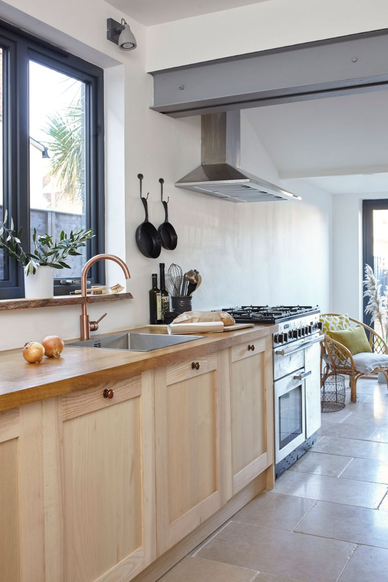 Kitchen with wood units in Victorian terrace on Isle of wight