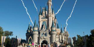 Fireworks go off behind Cinderella's castle at Disney World.