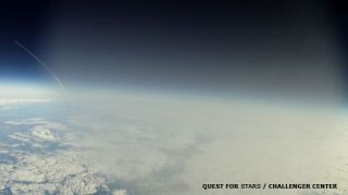 This frame grab from a video -- shot by a GoPro Hero Motorsport camera aboard the Robonaut-1 balloon -- shows the shuttle Discovery streaking toward space on its final mission. The shot was taken at 5:05 EST on Feb. 24, 2011 as the balloon was traveling t