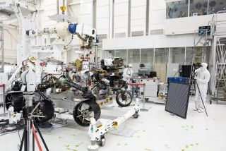 Engineers test cameras on the Mars 2020 rover in the Spacecraft Assembly Facility at NASA's Jet Propulsion Laboratory in Pasadena, California, on July 23, 2019.