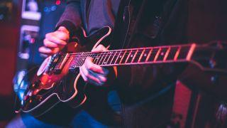 Guitar playing stock photo