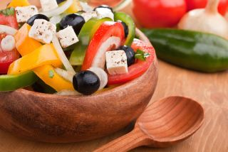 A salad with tomatoes, cheese and black olives