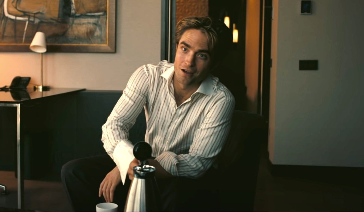 Tenet Robert Pattinson gets ready to pour some coffee