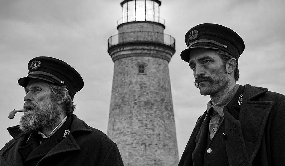 The Lighthouse, with Willem Dafoe and Robert Pattinson standing outside