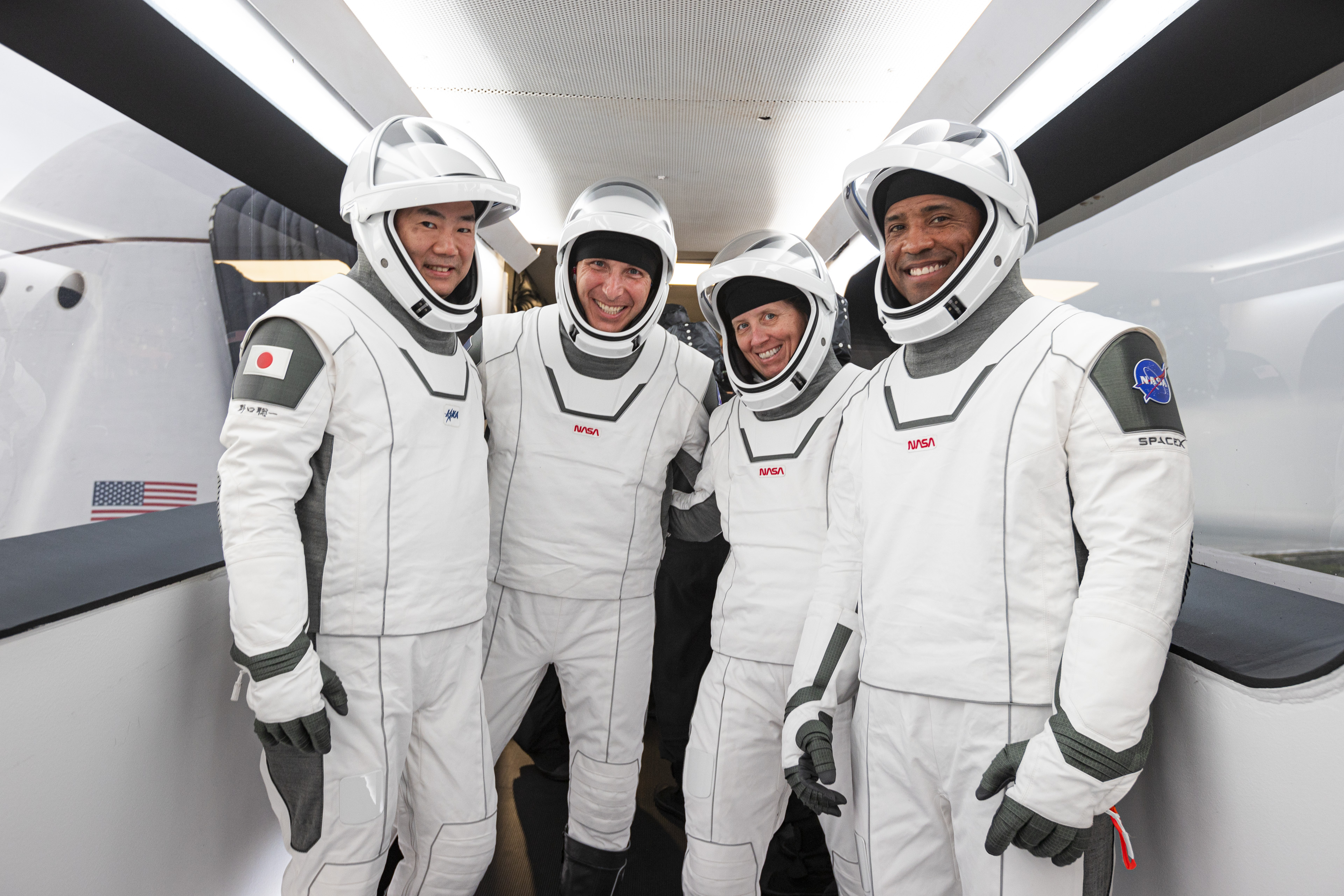 The four astronauts of NASA and SpaceX's Crew-1 mission to the International Space Station pose for a portrait during a launch rehearsal at Pad 39A of NASA's Kennedy Space Center in Cape Canaveral, Florida on Nov. 12, 2020. They are (from left): Japanese Aerospace Exploration Agency astronaut Soichi Noguchi and NASA astronauts Mike Hopkins, Shannon Walker and Victor Glover.