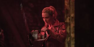 Millie Kessler (Kathryn Newton) holds a chainsaw while bathed in red light in 'Freaky'