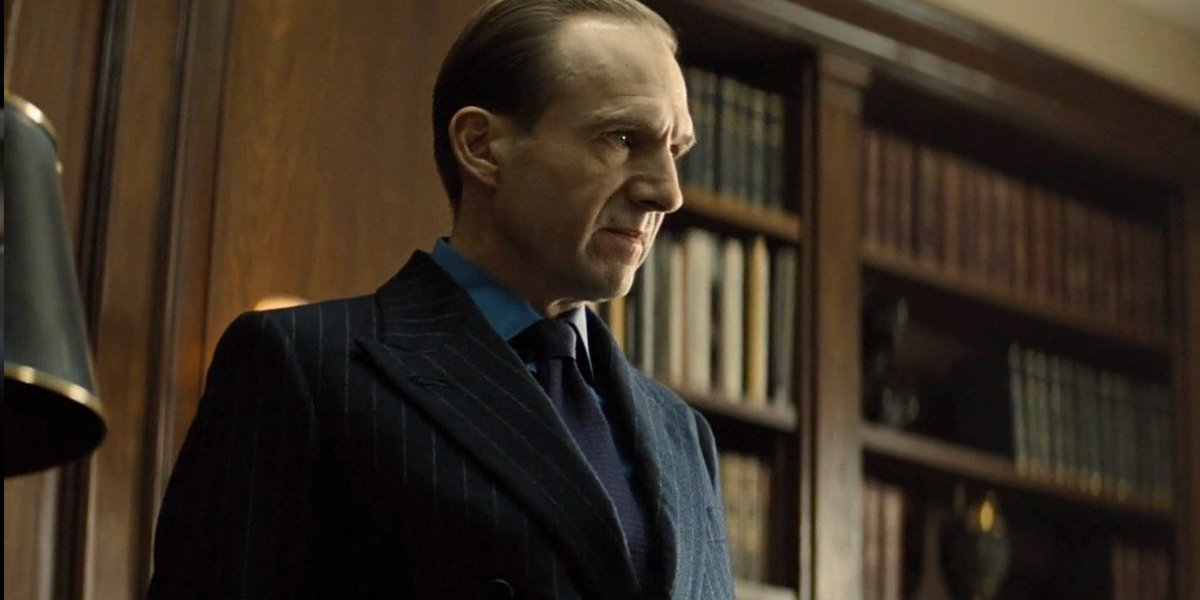 Ralph Fiennes stands in his office, looking rather mad, in Spectre.