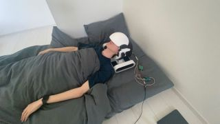 person wearing VR headset in bed