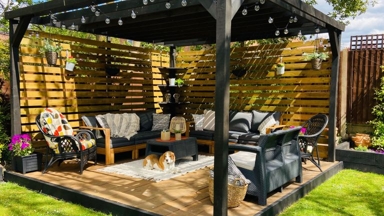 finished DIY pergola in garden with outdoor furniture