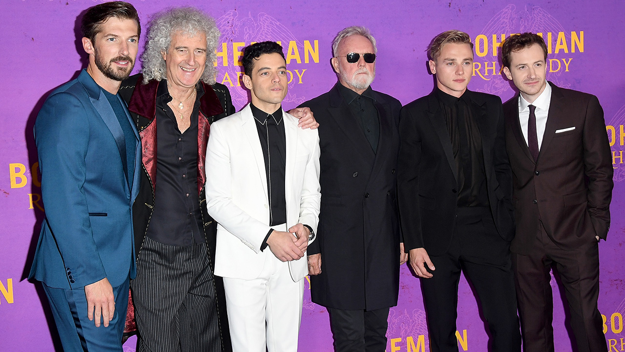 Watch as Brian May plays the Bohemian Rhapsody guitar solo for cast of the film